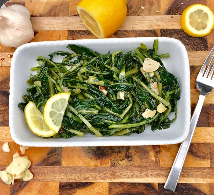 Finished dish of dandelion greens cooked with olive oil, garlic and lemon