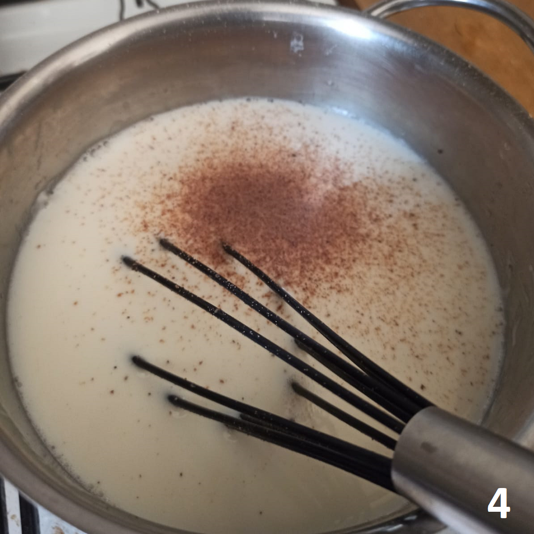 how to make béchamel sauce step 4_add milk and nutmeg and heat again